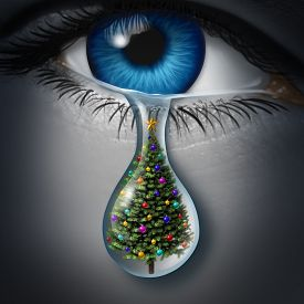 picture of sad christmas  - Holiday depression and winter season anxiety and emotional crisis concept as a human eyeball crying a tear with a christmas tree inside as a metaphor for seasonal sadness - JPG