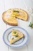stock photo of tarts  - Lemon tart with rosemary sweet quiche milk and fresh herbs from garden - JPG