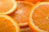 picture of valencia-orange  - background made of few sliced juicy oranges - JPG