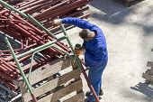 picture of air paint gun  - Photo of the Paint worker painting metal designs - JPG