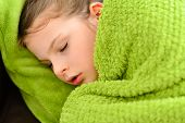 image of sick  - Sick child. Sick sweet little girl under a blanket
