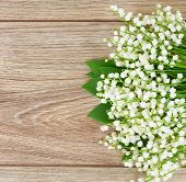 picture of lilly  - blooming lilly of the valley flowers posy border on wooden background - JPG