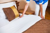 foto of maids  - Image of maid making bed in hotel room - JPG