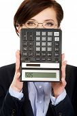 stock photo of sos  - Hopeless businesswoman with SOS writing on calculator - JPG