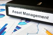 stock photo of asset  - Graphs and file folder with label Asset Management - JPG