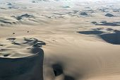 picture of buggy  - Sand dune landscape with two dune buggies in Huacachina Peru - JPG