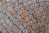 image of paving stone  - Backgrounds of pavement made of brown polished marble paving stones - JPG