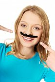 pic of moustache  - Happy teenage woman with a moustache - JPG