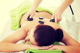 stock photo of stone-therapy  - Girl on a stone therapy - JPG