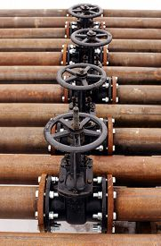 pic of gas-pipes  - Oil and gas pipeline valves on a rusty piping - JPG