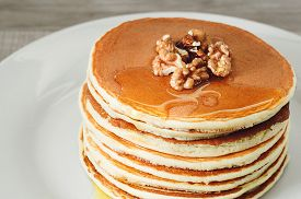 stock photo of breakfast  - breakfast of pancakes on a white plate - JPG
