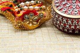 foto of rakhi  - Rakhi thread in a golden holder along with a beautiful box decorated with jewels - JPG