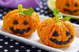 stock photo of jack o lanterns  - Pumpkin Rice Ball Jack O Lanterns for Halloween party - JPG
