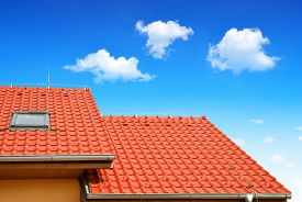 pic of red roof  - Roof house with tiled roof on blue sky - JPG