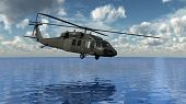 stock photo of attack helicopter  - helicopter over the water - JPG