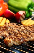 picture of barbecue grill  - steak on the grill - JPG