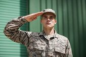 Close-up of military soldier giving salute in boot camp poster