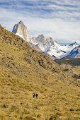 Постер, плакат: Two Men Walking At Trekking Road El Chalten Argentina