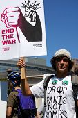 DENVER - AUGUST 26: An unidentified anti-war protestor holds a sign at a demonstration in Civic Cent