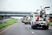 NEW ORLEANS - SEPT 2: A convoy of repair vehicles move along the I-10 freeway towards Baton Rouge in