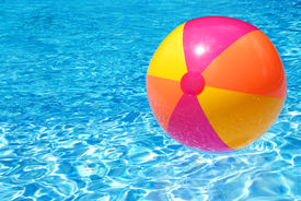 image of beach-ball  - A colorful beach ball floating on the swimming pool - JPG