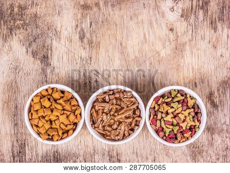 poster of Various Cat Food. Dry And Wet Cat Food. Cat Food In White Bowls. Copy Space