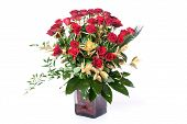 stock photo of flower arrangement  - Red roses with green and gold leafs in a glass vase - JPG