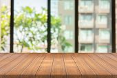 Empty Wood Table On Blurred Background Copy Space For Montage Your Product Or Design , Blank Brown B poster