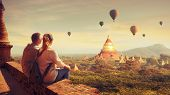 Happy Tourists, Friends, Enjoy Watching The Flight Of Balloons Over The Old Bagan In Myanmar. Young  poster