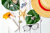 Summertime. Travel Accessories On Wooden Background Flat Lay poster