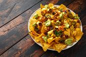 Mexican Nachos Tortilla Chips With Olives, Jalapeno, Guacamole, Tomatoes Salsa And Cheese Dip. poster