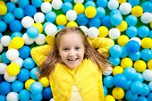Kids Play In Ball Pit. Child Playing In Balls Pool poster