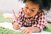 Cute Young African American Kid Girl Drawing Or Painting With Colored Pencil. Kindergarten Children  poster