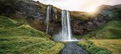 Magical Seljalandsfoss Waterfall In Iceland. poster