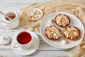 Close-up Of Meringue Mini Tarts With Browned Meringue Peaks Served With Tea, Mini Marshmallows And B poster