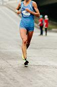 Front View Female Runner Running Street Of City Marathon poster