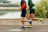 Two Elderly Men Runners Run Marathon Along Embankment Of River poster