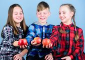 Promoting Healthy Nutrition. Group Teenagers Cheerful Kids Hold Apples. Boy And Girls Friends Eat Ap poster