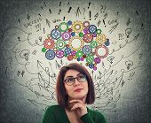 Portrait Of A Young Woman With Colorful Cogwheel Brain Above Head. Happy Emotion, Positive Thinking  poster