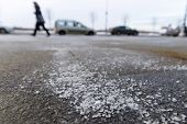 De-icing Chemicals On The Road. Pavement Is Sprinkled With Technical Salt Or Salt Mixtures Based On  poster