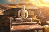 Ancient stone statue of a meditating Buddha in sunset light, Vatadage (Round House), Polonnaruwa, Sr poster