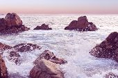 Sunset Seascape At Sri Lanka. Wave Crashing The Rock. Natural Background In Pink Tone. Beautiful Eve poster