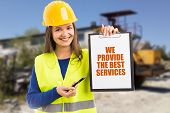 Smiling Woman Wearing Fluorescent Vest And Yellow Safety Helmet Advertising Construction Company Wit poster