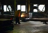 Industrial Worker At An Automotive Plant For The Production Of Pit Dumpers And Bulldozers, Welding I poster