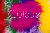 Red Blue, Green, Pink And Yellow Color Word On Colorful Color Powder poster