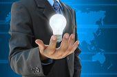 image of light-bulb  - the businessman hand holding a light bulb - JPG