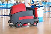 Woman Driving Professional Floor Cleaning Machine At Airport Or Railway Station Or Supermarket. Floo poster