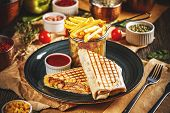 Wrap With Grilled Chicken Served With Chili Sauce And French Fries poster