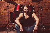 Theres Music In The Air. Enjoying Instrumental Music. Handsome Man Sit On Stage At Percussion Instru poster