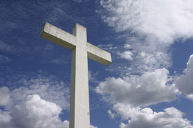 foto of christian cross  - Huge Christianity cross and natural sky background - JPG